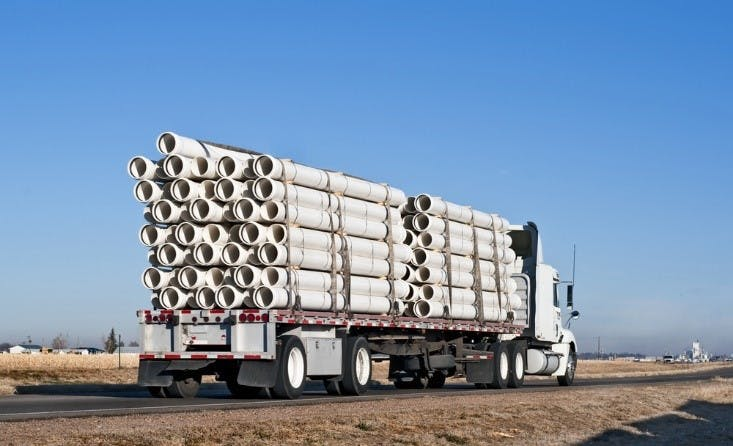 flatbed trailer hauling construction materials