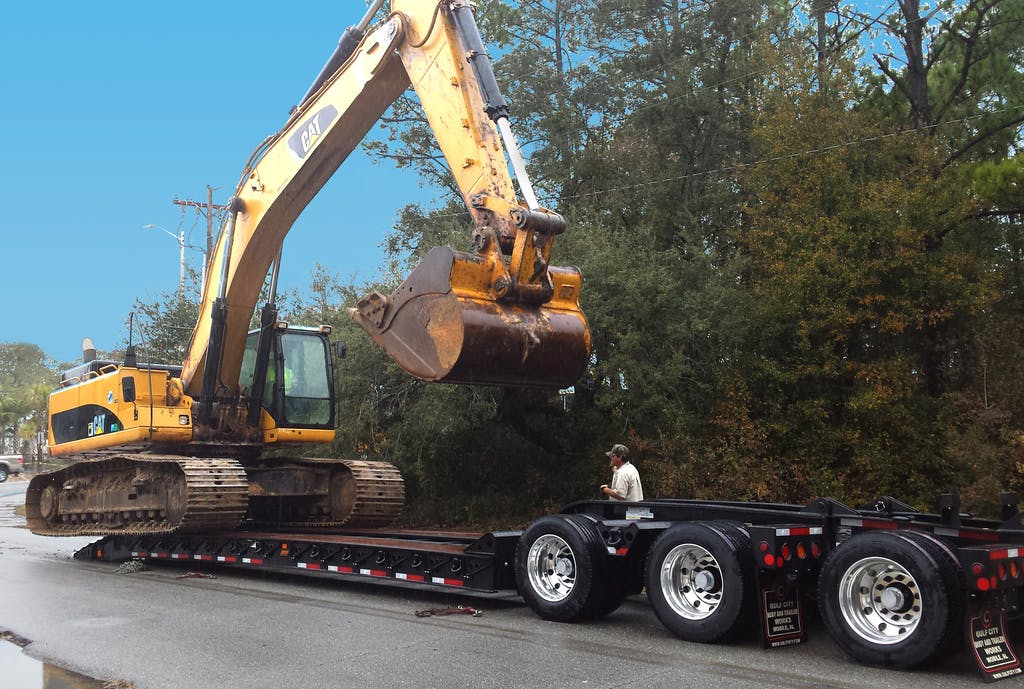 lowboy trailer for hauling construction equipment